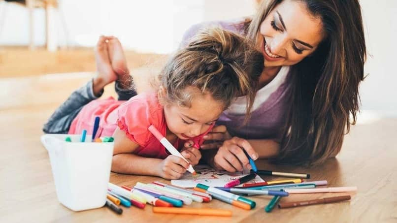 little girl learn coloring together mom