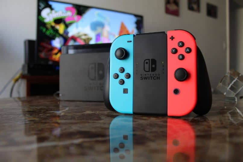 television with nintendo switch console in front