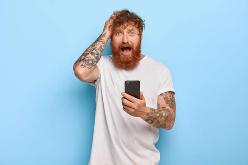 surprised man holds phone