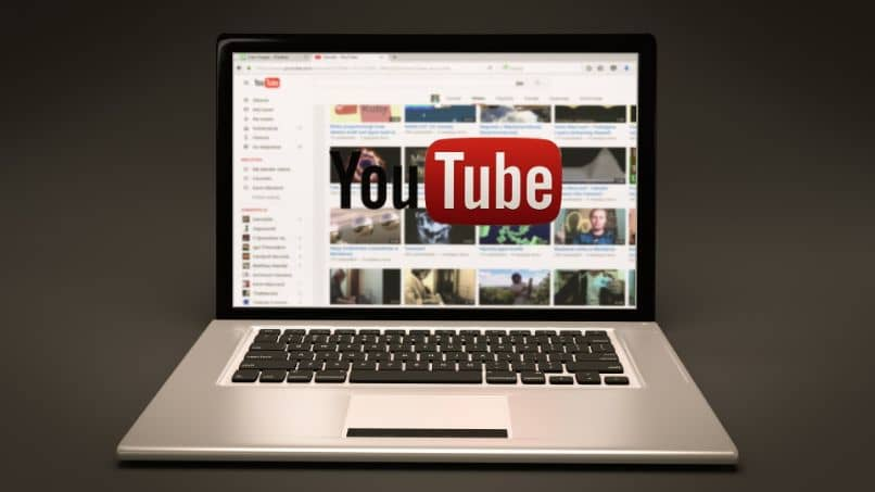 laptop with youtube page logo