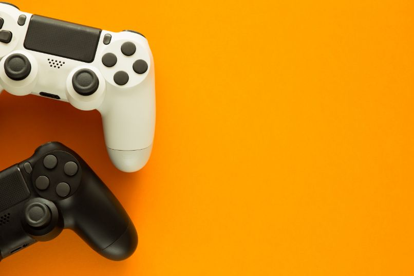 pair of black and white ps4 controls