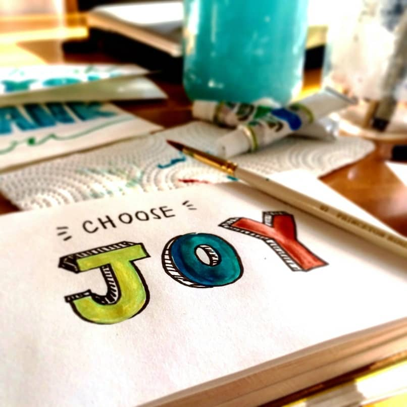 sheet of paper with the word joy