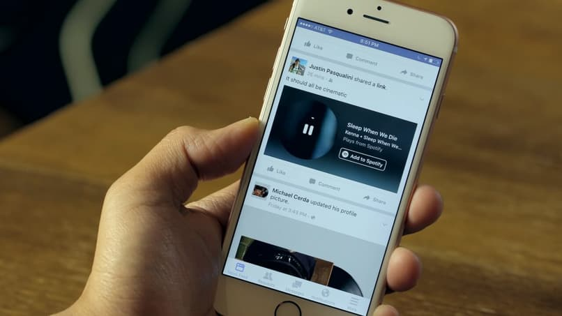 person uses social network facebook on his phone