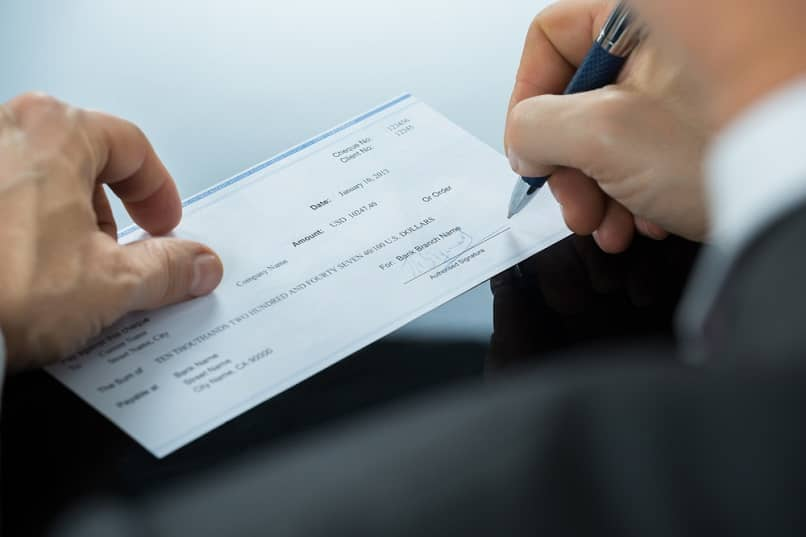 person filling in check payment sign