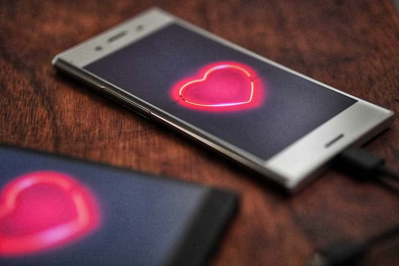 two phones with hearts