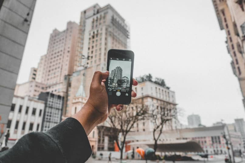 person taking a picture with his phone