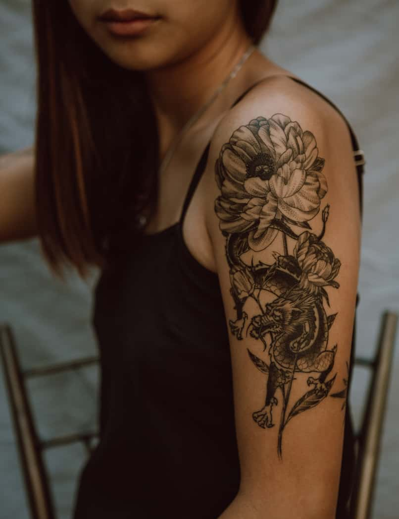 woman uses application to design tattoos