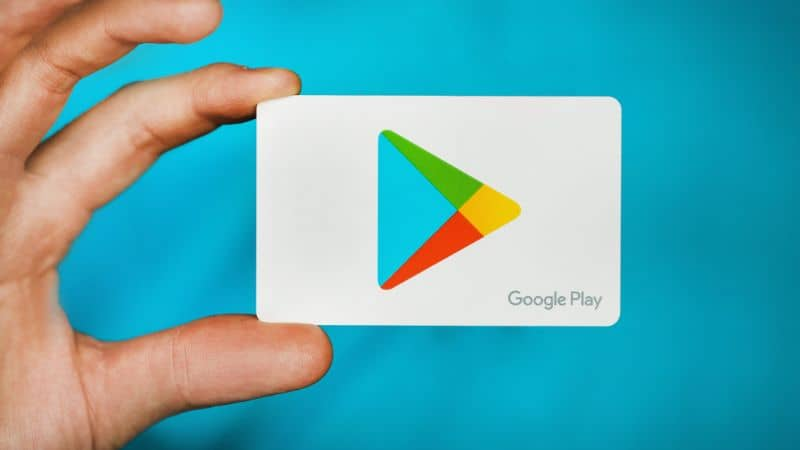 Play Store logo in hand Green background