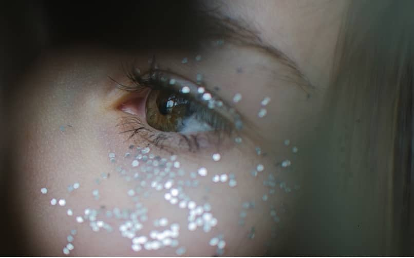 girl with glitter on her face