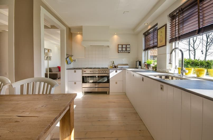 panoramic view of a dining room and kitchen