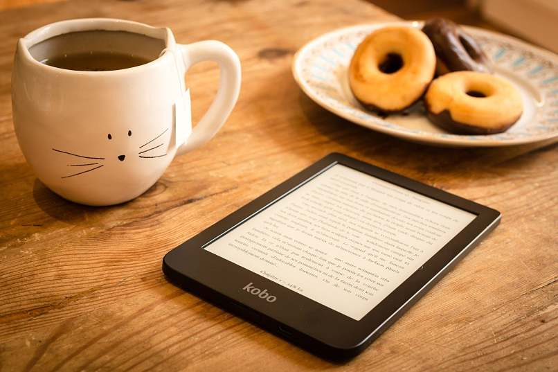 tablet with ebook and donuts