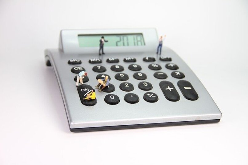 calculator with people sitting on it