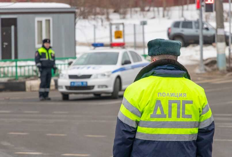 policemen inspecting drivers