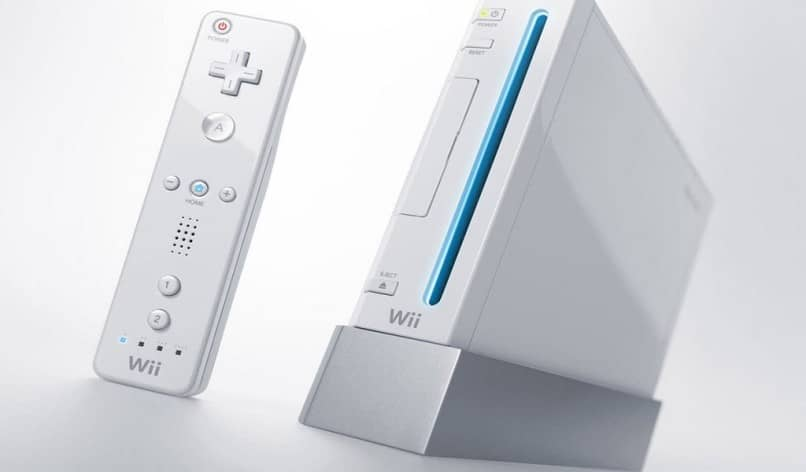 white wii console and controller