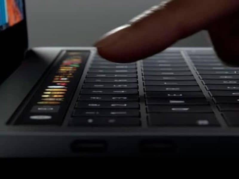 index finger about to touch mac keyboard