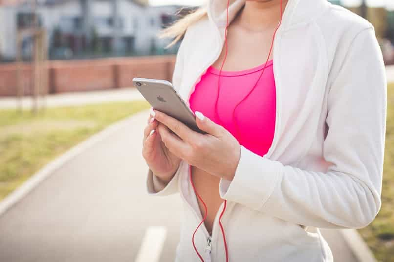 person with iphone using the health app