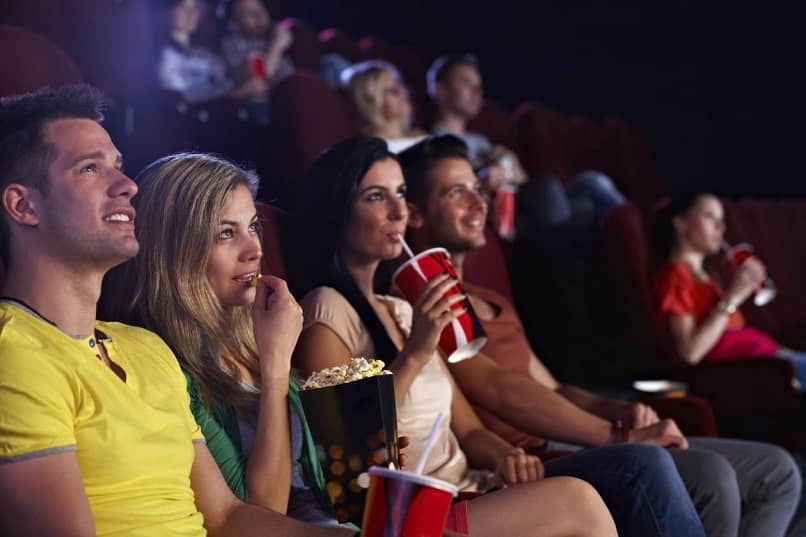 group of young people enjoying a movie