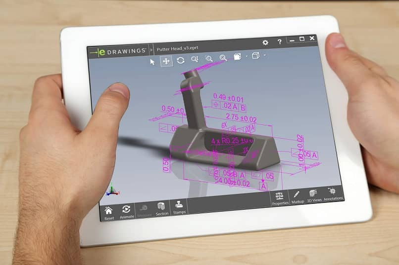 hands modifying an edrw image on a tablet