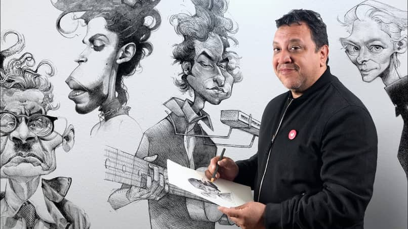 cartoonist with his works