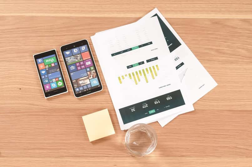 papers and cell phone for horizontal marketing