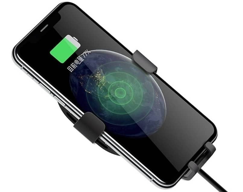 device charging with a charger and looks on the screen