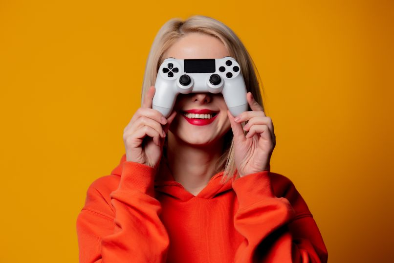 woman with ps4 controller on her face