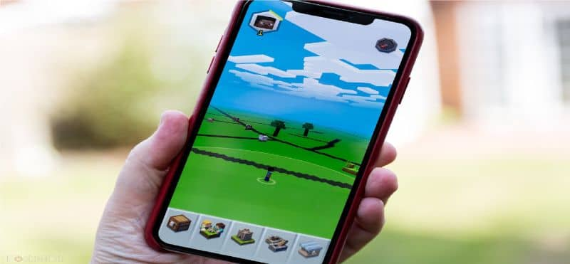 hand with mobile and minecraft game